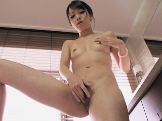 Sexy Kotomi rubbing and toying her wet and hairy pussy