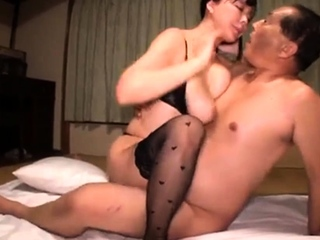 Busty Asian wife in stockings has a passion for cock and cum