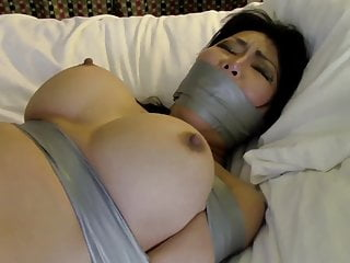 Busty Japanese tied and gagged with tape on bed